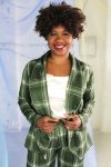 Straight size black model with short curly hair wearing green plaid suit and cream satin camisole, ethically handmade in NYC